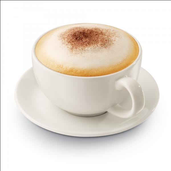 Café espresso ( dans une grande tasse )avec du lait entier préalablement chauffé à la vapeur et mousseux .