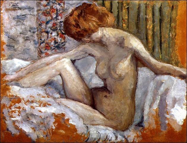 Marthe nue sur son lit.