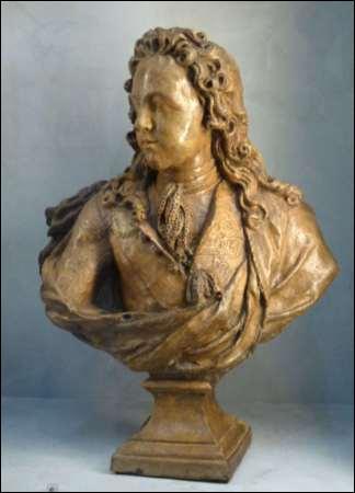 On lui doit de nombreux bustes de l'époque classique :  Colbert   Louis XV enfant  et des sujets mythologiques. Qui est-ce ?
