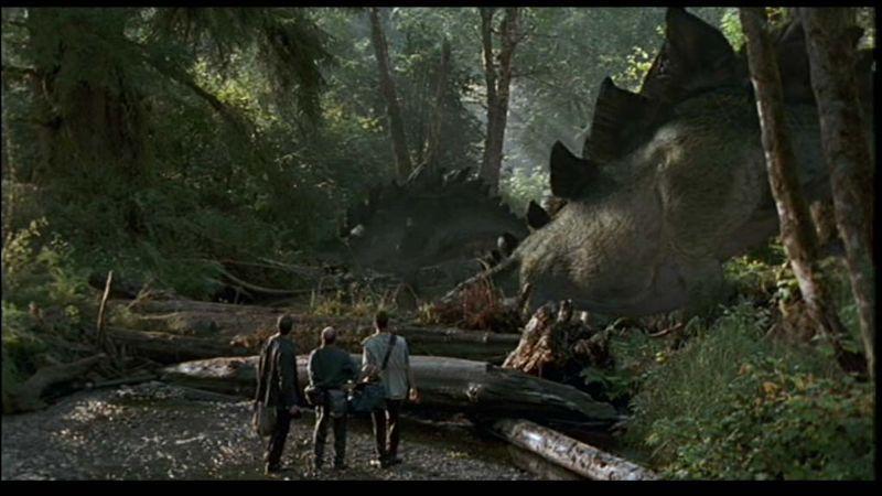 Quel dinosaure ces trois personnes regardent-elles ?