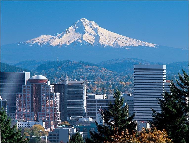 Appartenant à la région économique du Pudget Sound tout comme Seattle, dans quel état la ville de Portland est-elle située ?