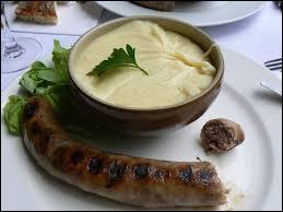 Quel est ce plat réalisé à base de tome et de purée de pommes de terre assaisonné d'ail pilé ?