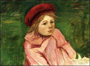 Petite fille avec un béret rouge.