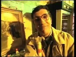 Dans la fausse pub ''C'est possible'' , quel était le nom du commerçant chez qui Alain Chabat achetait des chaussures en croco, une pendule plaquée or, un cadre, des cacahuètes, un costume bleu qu'il faisait livrer chez lui tout en payant plus tard ?