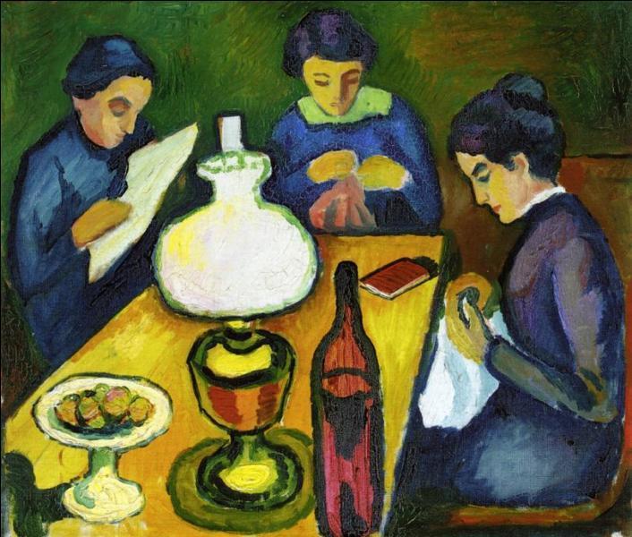 Trois femmes à table sous la lampe.