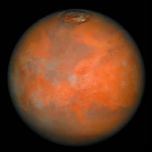 Cette planète doit sa couleur rouge à ses roches pleines de rouille et son ciel rosi par les tempêtes de poussière. Elle est creusée de canaux semblables à des lits de rivières asséchées, mais il n'y a pas d'eau. On y trouve des vallées profondes et d'anciens volcans. Quelle planète est-ce ?
