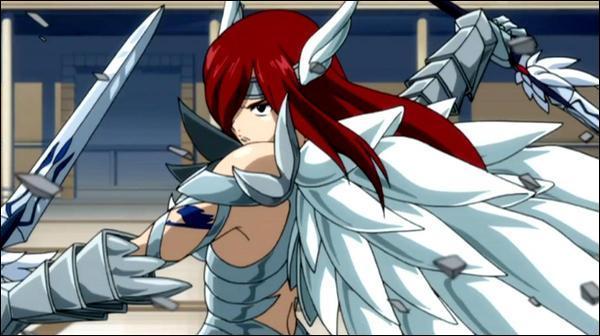 Comment s'appelle cette mage de rang S, membre de la guilde de Fairy Tail surnommée 'Titania' et utilise une magie qui permet d'invoquer des armures et des épées ?
