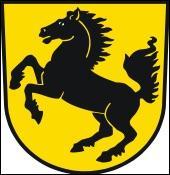 Qui a-t-il écrit et en photo au centre du logo de Porsche ?