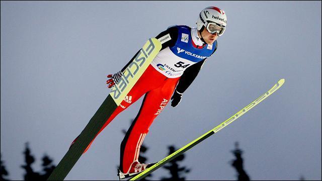Dans l'épreuve du saut à ski, quelle est la hauteur du grand tremplin ?