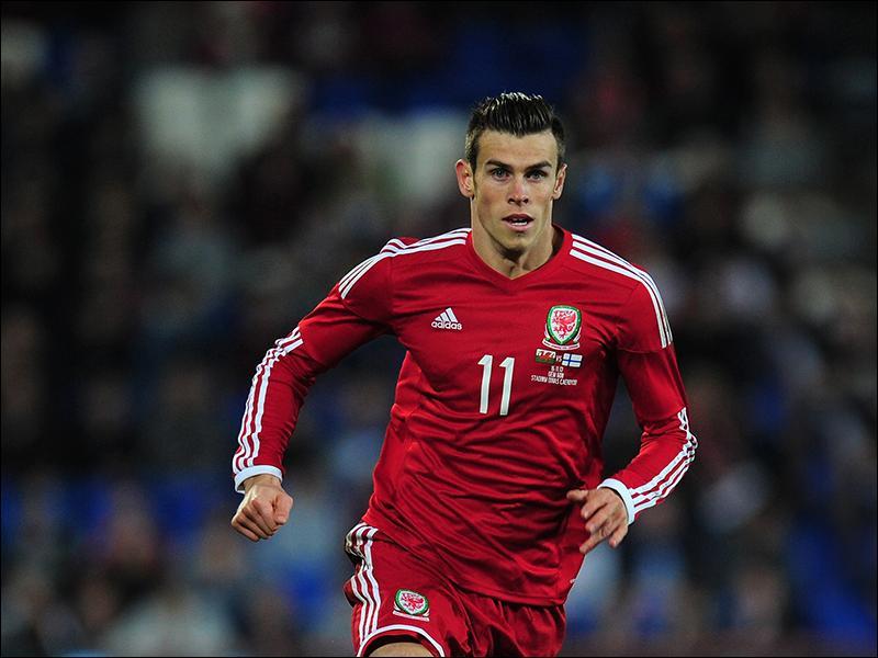 Contre quelle équipe a-t-il inscrit son premier but avec le pays de Galles ?