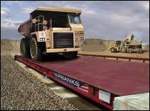 Un camion pesé à vide puis pesé avec sa marchandise est un camion...