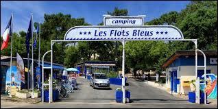 """Quel est le numéro de l'emplacement au camping """"Les Flots Bleus"""" du couple Pic dans le film """"Camping"""" ?"""