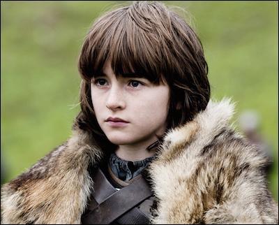 Avec qui Bran Stark arrive-t-il au nord du mur ?