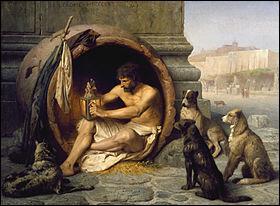 C'est Antisthène, disciple de Socrate, qui institua le courant cynique, qui tient son nom du gymnase Cynosarge (to Kynosarges) dans le quartier du Chien Blanc, où se réunissaient ses membres. Je vous laisse trouver le nom de son célèbre disciple, qui a fait de l'anti-conformisme (au bas mot) son mode de vie.