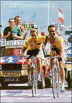 Qui accompagnait Bernard Hinault lorsqu'ils franchirent main dans la main l'arrivée d'une étape du Tour de France 1986 à l'Alpe d'Huez ?