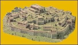 Qui est le dieu protecteur de la ville de Troie ?