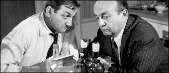 (B. Blier) : Ben c'est devant chez elle que Lucien le Cheval s'est fait dessouder. (L. Ventura) : Et par qui, hein ? (B. Blier) : Bah, v'la que j'ai plus ma tête ! (L. Ventura) : Par Teddy de Montréal, un fondu qui travaillait ---------------------------------(B. Blier) : Toute une époque !