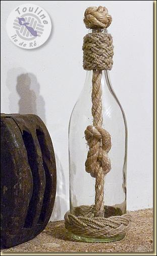 Il n'est certes pas nécessaire de le mettre dans une bouteille, mais d'en donner le nom !