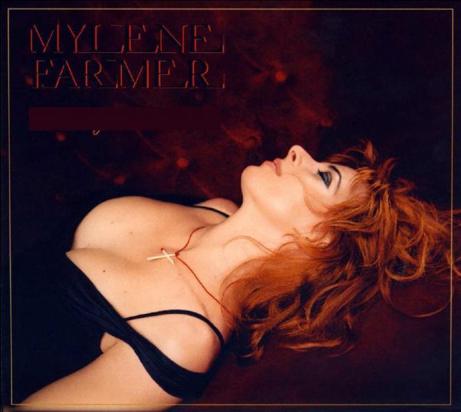 """Sixième album studio avec les titres """"Fuck Them All"""", """"Q.I"""" et """"Peut-être toi""""."""