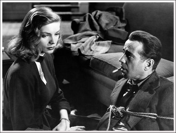 Le détective Philip Marlowe est bien ficelé sous les yeux de Lauren Bacall dans...