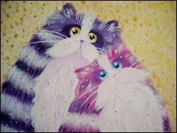 Deux chats nous regardent.