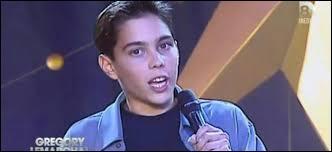 À quel télé-crochet musical a-t-il participé lorsqu'il était adolescent à la fin des années 90 ?