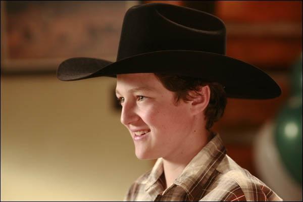 Comment s'appelle le petit ami cowboy de Malory ?